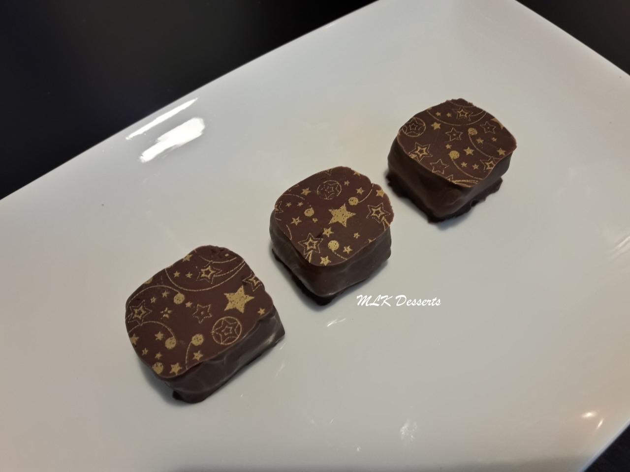 Ganache cadrée chocolat framboise avec un enrobage chocolat au lait